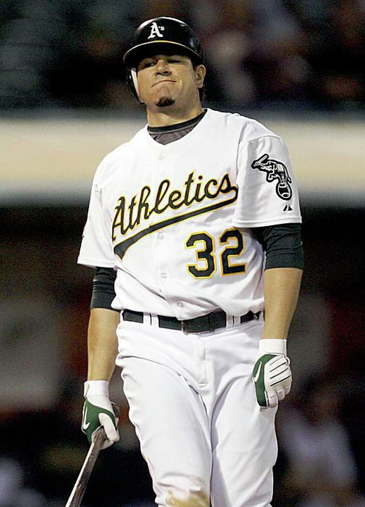 Oakland Athletics' Jack Cust reacts after striking out against Texas Rangers in the ninth inning of an MLB baseball game, Friday, Sept. 12, 2008 in Oakland, Calif. Rangers won 7-0. (AP Photo/Tony Avelar)