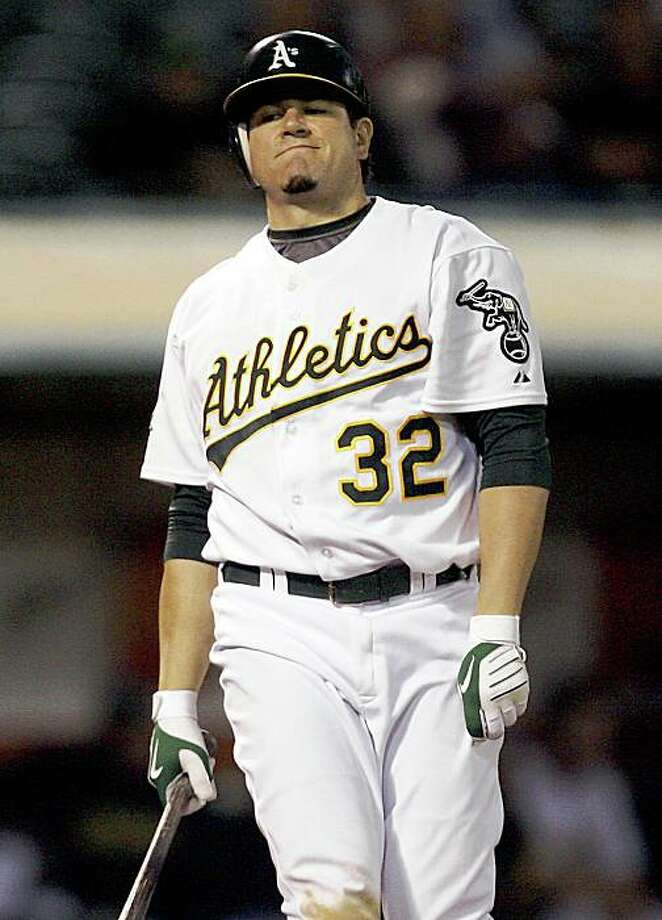 Oakland Athletics' Jack Cust reacts after striking out against Texas Rangers in the ninth inning of an MLB baseball game, Friday, Sept. 12, 2008 in Oakland, Calif. Rangers won 7-0. (AP Photo/Tony Avelar) Photo: Tony Avelar, AP