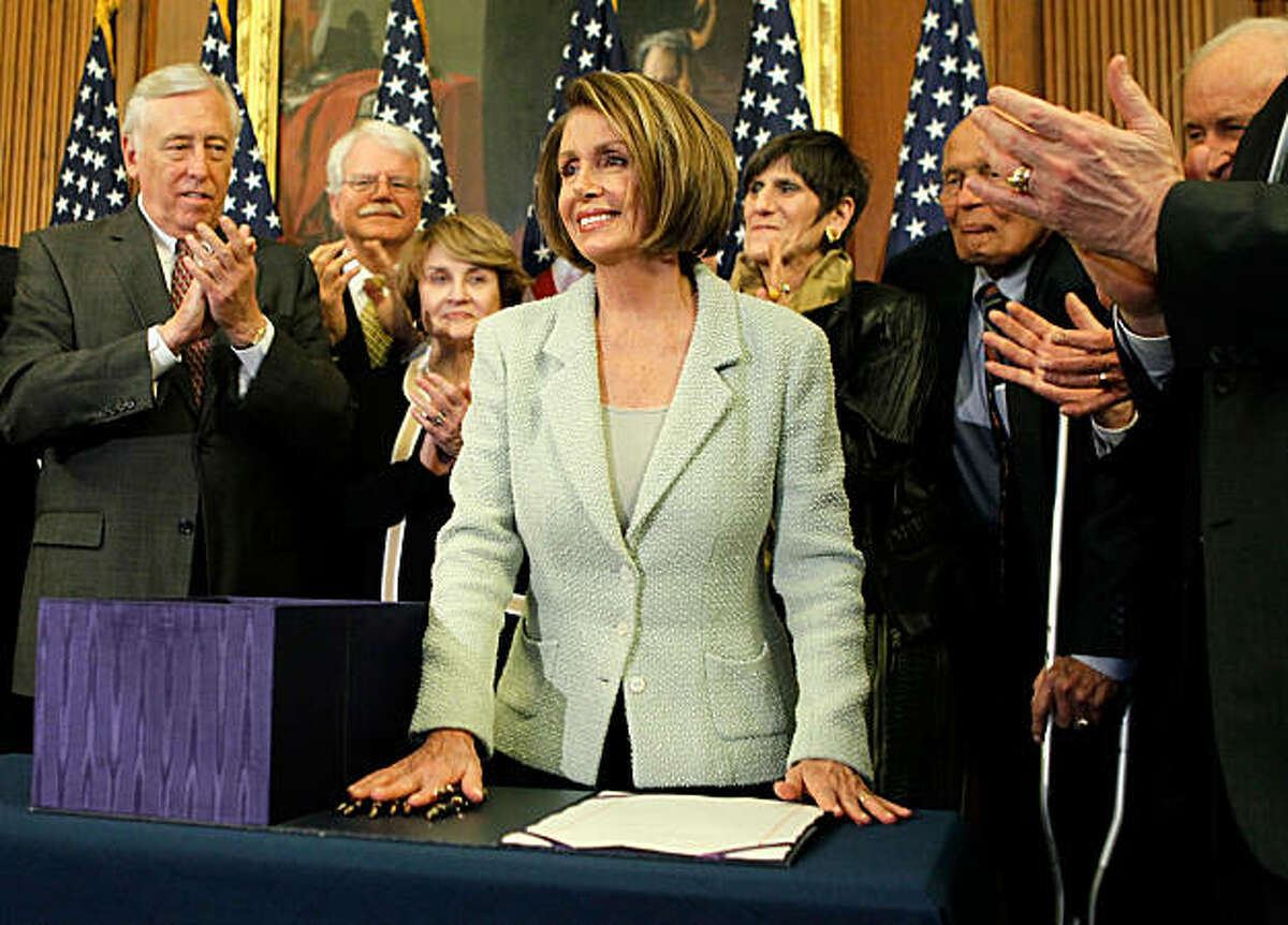 WASHINGTON - MARCH 22: Surrounded by Democratic House members, (L-R) House Majority Leader Rep. Steny Hoyer (D-MD), Rep. George Miller (D-CA), Rep. Louise Slaughter (D-NY), Rep. Rosa DeLauro (D-CT), and Rep. John Dingell (D-MI) applaud as U.S. Speaker ofthe House Rep. Nancy Pelosi (D-CA) (C) stands up after she signed the Senate Health Reform bill March 22, 2010 on Capitol Hill in Washington, DC. The House has passed the Senate version of the legislation the night before by a vote of 219 to 212. U.S. President Barack Obama intends to sign the measure on Tuesday.