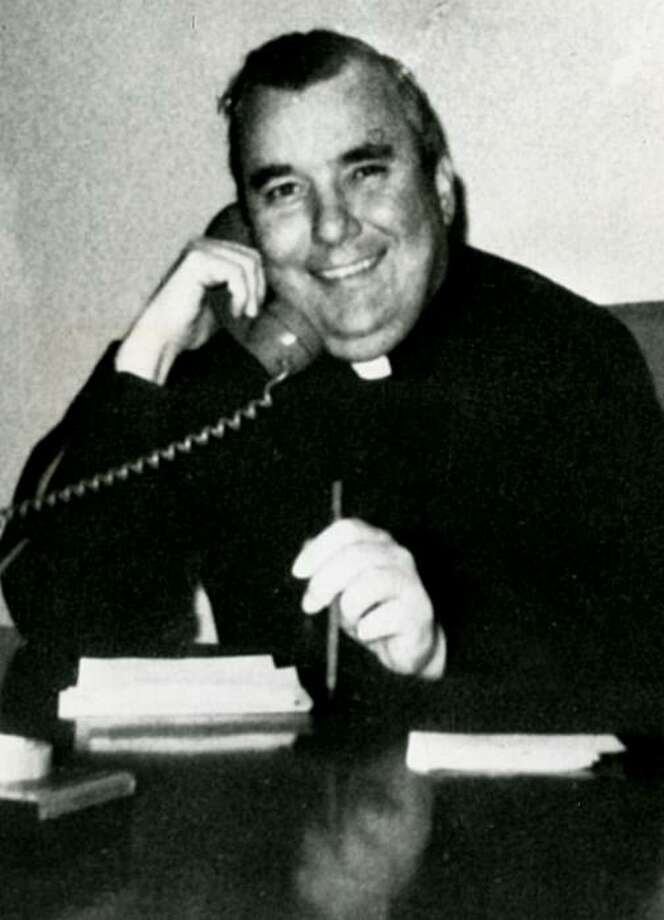 In this 1974 file photograph, Father Lawrence C. Murphy is shown working at St. John's School for the Deaf in St. Francis, Wisconsin. On Thursday, March 25, 2020, a victim of molestation perpetrated by Father Murphy recounted his abuse in a news conference outside the headquarters of the Archdiocese of Milwaukee. (Milwaukee Journal Sentinel files/MCT) Photo: Milwaukee Journal Sentinel, File, MCT