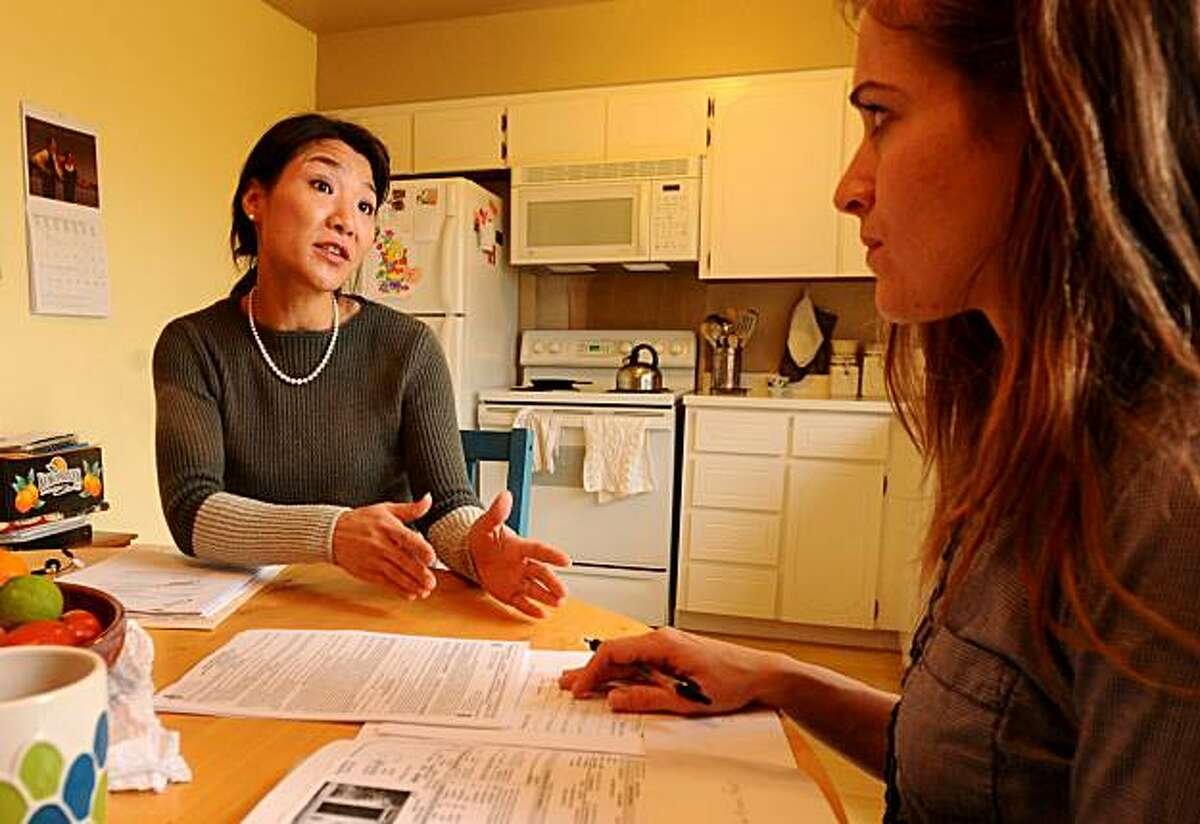 Realtor Patty Hyun speaks with Nissa Anderson-Lyman on Friday, Feb. 12, 2010, in San Leandro, Calif. Anderson-Lyman hopes to unload her townhouse as a short sale.
