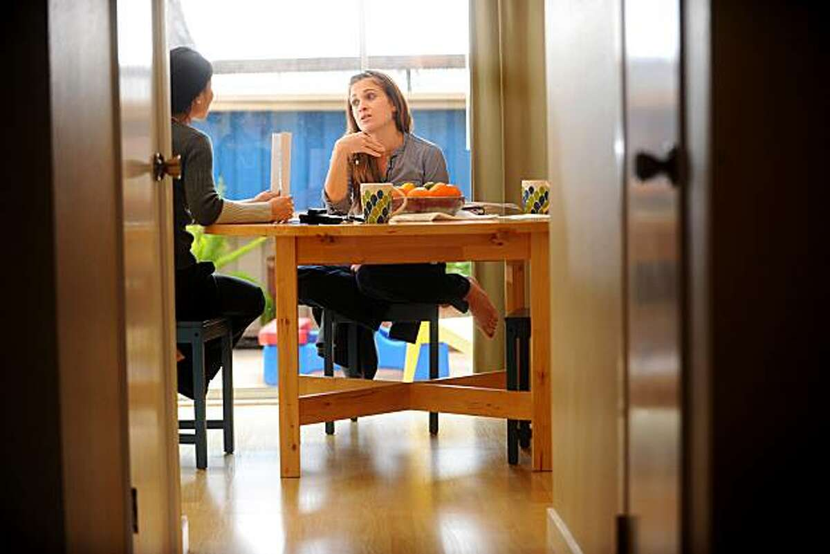 Nissa Anderson-Lyman, who hopes to unload her San Leandro, Calif., townhouse as a short sale, speaks with her realtor, Patty Hyun, on Friday, Feb. 12, 2010.