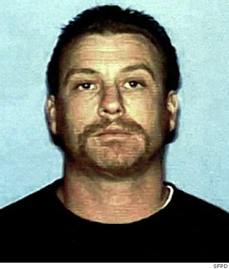 Suspect in Hells Angels killing surrenders - SFGate