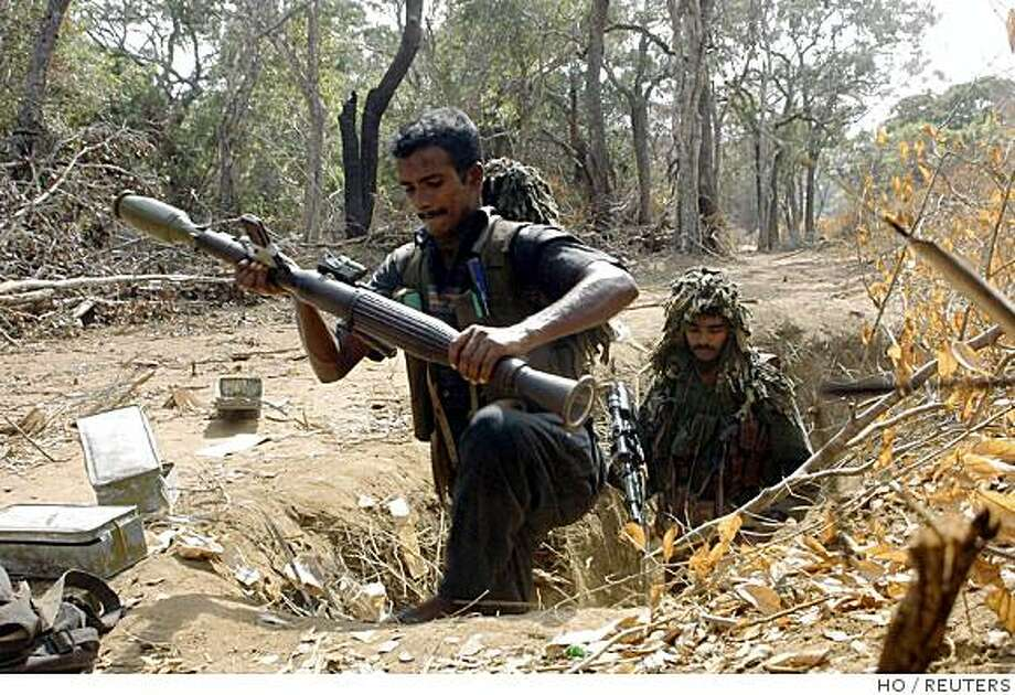This picture provided by the Tamil Tiger rebels picture shows rebels fighting against Sri Lanka's military in Vannearikku'lam village, in the de facto rebel capital of Kilinochchi, 330 km (205 miles) north of the capital Colombo September 2, 2008. Battles between Sri Lanka's military and separatist Tamil Tiger guerrillas killed at least 57 people when the rebels counterattacked against an army thrust into their strongholds, the military said on Sept. 3, 2008. Picture taken September 2, 2008. REUTERS/Tamil Tiger Rebels/Handout  (SRI LANKA).  NO SALES. NO ARCHIVES. FOR EDITORIAL USE ONLY. NOT FOR SALE FOR MARKETING OR ADVERTISING CAMPAIGNS. Photo: HO, REUTERS