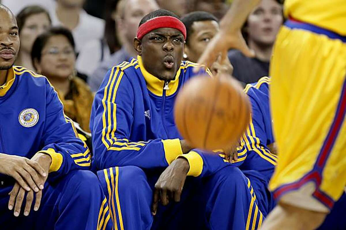 The Warriors Anthony Morrow watches the action during the first quarter from the bench as the Golden State Warriors take on the Memphis Grizzlies in NBA action in Oakland, Calif. on Wednesday Mar. 24, 2010.