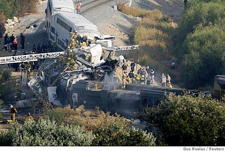 REFILE - CAPTION CLARIFICATION Firefighter work to rescue victims after a Metrolink commuter train en route from Los Angeles' Union Station to Oxnard collided with a freight train in the Chatsworth area, September 12, 2008. Over 300 firefighters are working to douse flames and rescue victims, according to the Los Angeles Fire Department.  REUTERS/Gus Ruelas (UNITED STATES) Photo: Gus Ruelas, Reuters