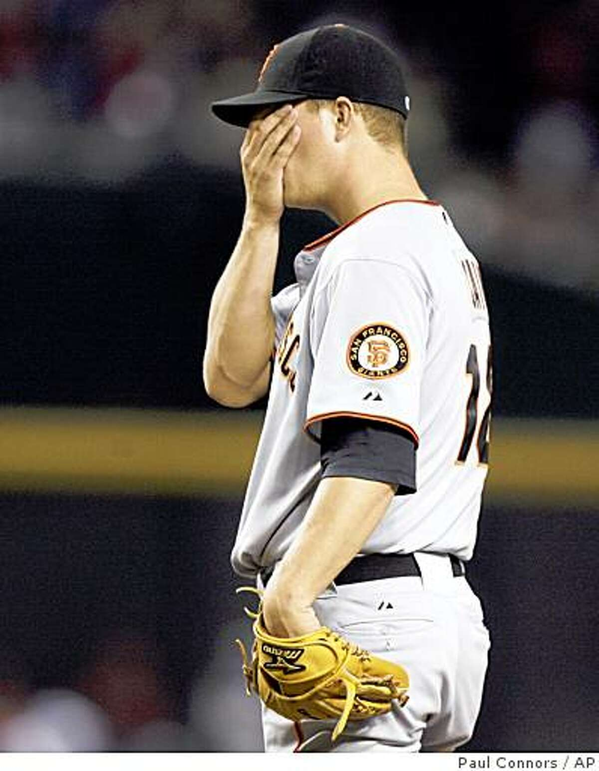 San Francisco Giants' Matt Cain reacts to giving up a solo home run to Arizona Diamondbacks' Chris Snyder in the third inning of a baseball game, Tuesday, Sept. 16, 2008, in Phoenix. (AP Photo/Paul Connors)