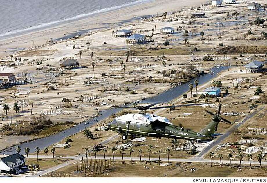 Marine One flies U.S. President George W. Bush over areas near Galveston, Texas, that were devastated by Hurricane Ike September 16, 2008. REUTERS/Kevin Lamarque   (UNITED STATES) Photo: KEVIN LAMARQUE, REUTERS