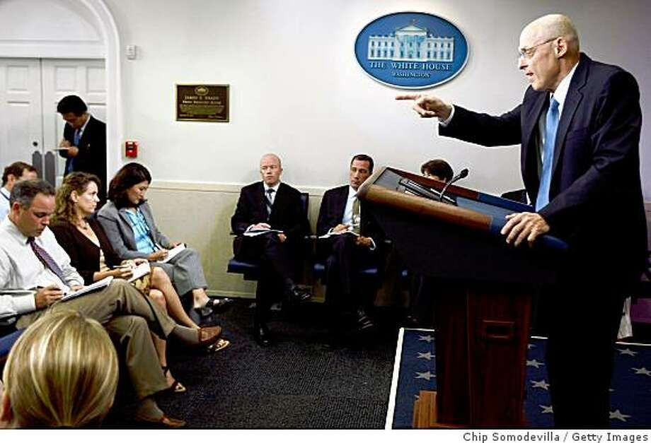 WASHINGTON - SEPTEMBER 15:  U.S. Treasury Secretary Henry Paulson talks to members of the news media about the ongoing crisis rocking Wall Street at the White House September 15, 2008 in Washington, DC. The markets fell more than 270 points by midday on the news that Paulson and the federal goverment refused to use taxpayer money to bail out investment banking house Lehman Brothers Holdings Inc.  (Photo by Chip Somodevilla/Getty Images) Photo: Getty Images