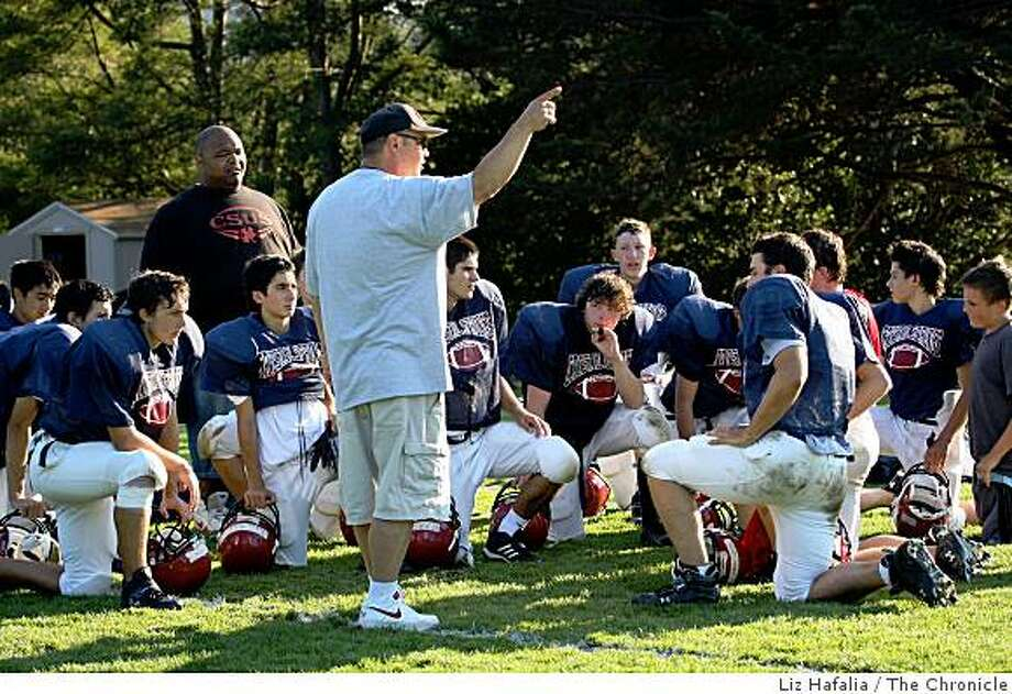 Coach Kevin Thorson (front) get the team ready for an upcoming game against Pinewood during football practice at Crystal Springs Upland High School  in Hillsborough, Calif., on Monday, September 15, 2008. Photo: Liz Hafalia, The Chronicle