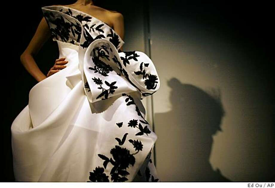 A white satin organza strapless gown with black floral embroidery  dreamy Marchesa gown for spring 2009 collection is modeled during Fashion Week in New York, Wednesday, Sept. 10, 2008. (AP Photo/Ed Ou) Photo: Ed Ou, AP