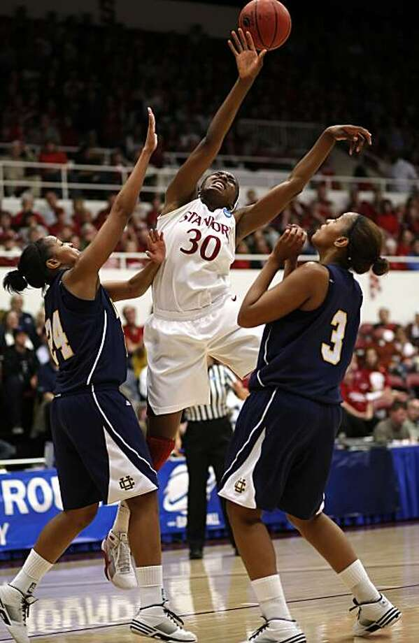 Stanford's Nnemkadi Ogwumike (30) splits between UC Riverside's Tre'Shonti Nottingham (14) and Rheya Neabors (3) in the first half as the Stanford Cardinal take on the UC Riverside HIghlanders in first round action in the 2010 NCAA women's basketball championship at Maples Pavilion in Palo Alto, Calif. on Saturday Mar. 20, 2010. Photo: Michael Macor, The Chronicle