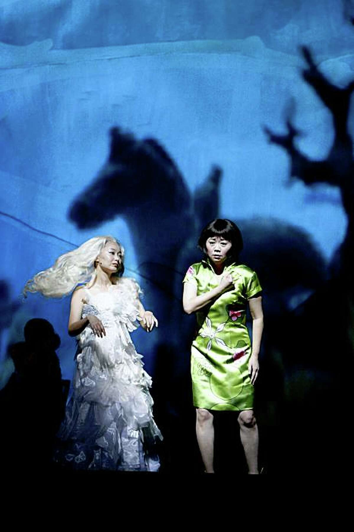 Precious Auntie, played by Qian Yi, left, and Ruth Young Kamen, played by Zheng Cao, right, at the dress rehearsal of SF Opera's world premier of the opera based on the Amy Tan novel