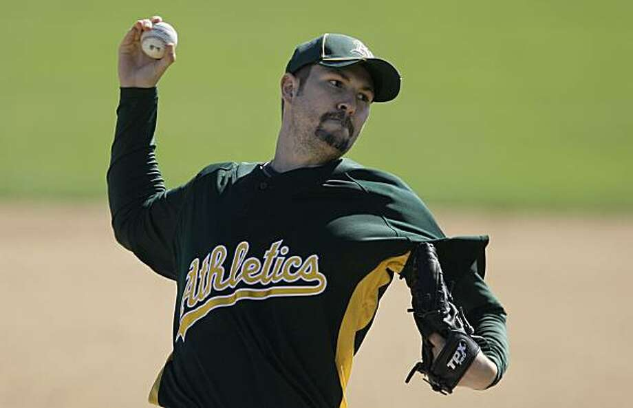 Oakland Athletics' Justin Duchscherer pitches during an intrasquad baseball game at the Athletics' baseball spring training facility in Phoenix, Wednesday, March 17, 2010. Photo: Jeff Chiu, AP