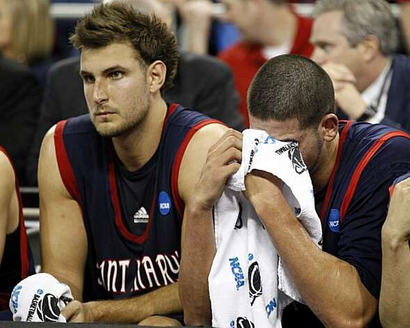 Saint Mary's Omar Samhan, right, wipes his eyes near the end of the NCAA South Regional semifinal college basketball game against Baylor in Houston, Friday, March 26, 2010. Baylor defeated Saint Mary's 72-49. At left is Saint Mary's Ben Allen. Photo: David J. Phillip, AP
