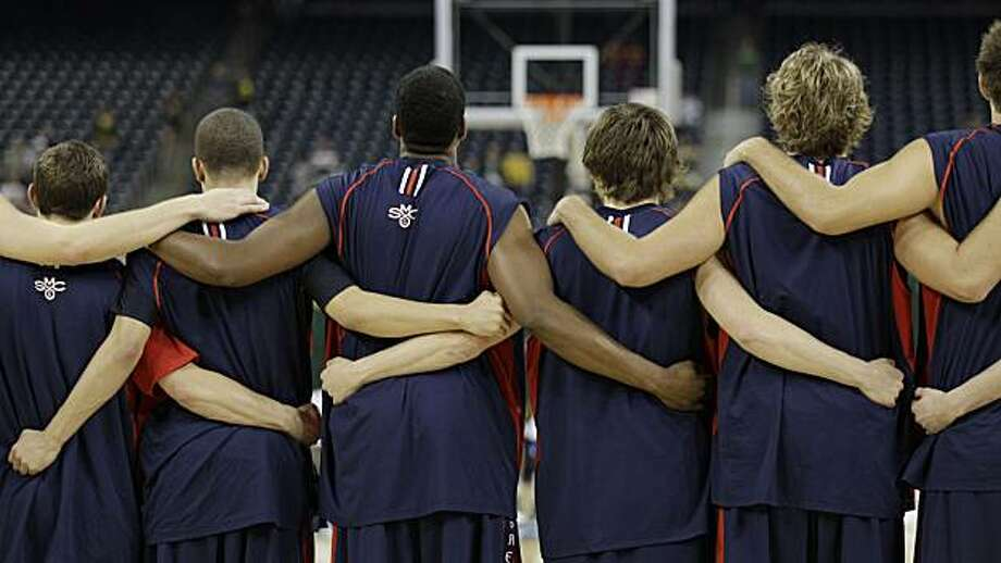 Members of the Saint Mary's basketball team stand together during the national anthem before an NCAA South Regional semifinal college basketball against Baylor in Houston on Friday. Photo: Eric Gay, AP