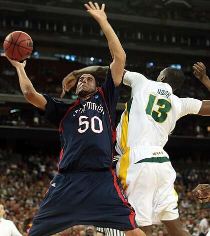 Omar Samhan of St. Mary's is fouled by Ekpe Udoh of Baylor in the first half of their NCAA Tournament game on Friday in Houston. Photo: George Bridges, MCT