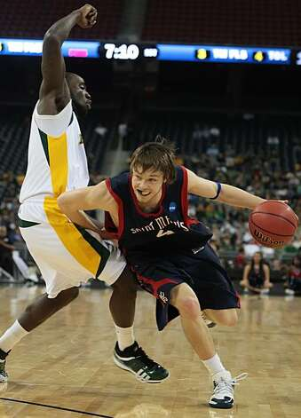Matthew Dellavodova of St. Mary's (4), right, drives by Quincy Acy of Baylor (4) in the first half of their NCAA Tournament game on Friday, March 26, 2010, in Houston, Texas. (George Bridges/MCT) Photo: George Bridges, MCT