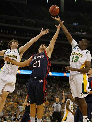 Ben Allen of the St. Mary's Gaels battles for a rebound with Josh Lomers and Ekpe Udoh of the Baylor Bears during the south regional semifinal of the 2010 NCAA men's basketball tournament at Reliant Stadium on Friday in Houston. Photo: Jonathan Daniel, Getty Images