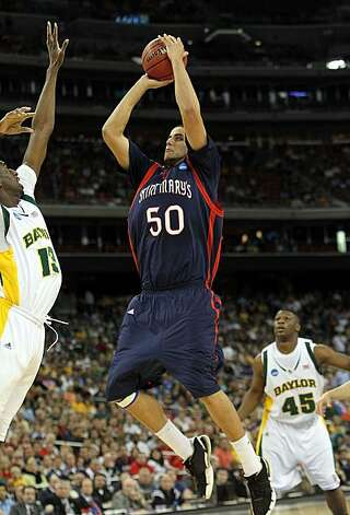 Center Omar Samhan of the St. Mary's Gaels takes a shot against Ekpe Udoh of the Baylor Bears during the south regional semifinal of the 2010 NCAA men's basketball tournament at Reliant Stadium on Friday in Houston. Photo: Ronald Martinez, Getty Images