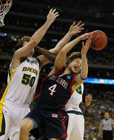 HOUSTON - MARCH 26: Matthew Dellavedova #4 of the St. Mary's Gaels tries to grab a rebound under pressure from Josh Lomers #50 and Ekpe Udoh #13 of the Baylor Bears during the south regional semifinal of the 2010 NCAA men's basketball tournament at Reliant Stadium on March 26, 2010 in Houston, Texas. Photo: Jonathan Daniel, Getty Images
