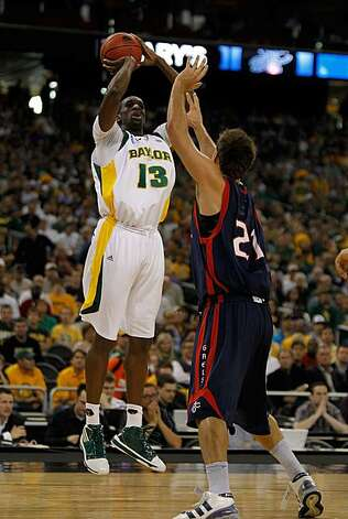 HOUSTON - MARCH 26: Ekpe Udoh #13 of the Baylor Bears puts up a shot over Ben Allen #21 of the St. Mary's Gaels during the south regional semifinal of the 2010 NCAA men's basketball tournament at Reliant Stadium on March 26, 2010 in Houston, Texas. Photo: Jonathan Daniel, Getty Images