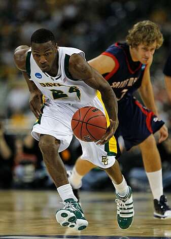HOUSTON - MARCH 26: LaceDarius Dunn #24 of the Baylor Bears breaks up the court after stealing the ball from Mitchell Young #3 of the St. Mary's Gaels during the south regional semifinal of the 2010 NCAA men's basketball tournament at Reliant Stadium on March 26, 2010 in Houston, Texas. Photo: Jonathan Daniel, Getty Images