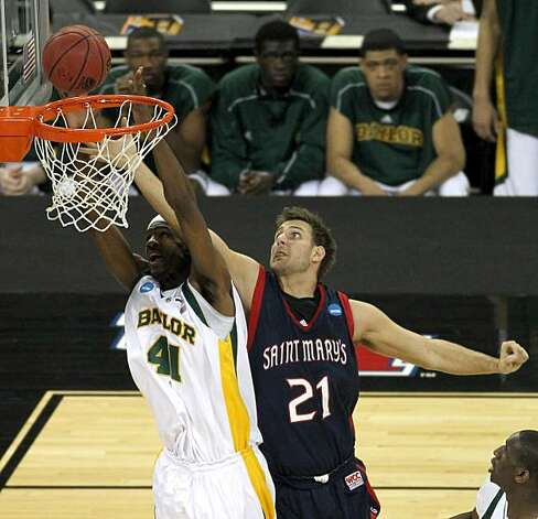 Baylor forward Anthony Jones grabs a rebound away from Saint Mary's forward Ben Allen during NCAA South Regional basketball action on Friday in Houston. Photo: Smiley N. Pool, Chronicle