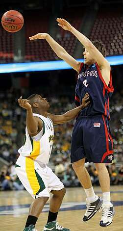 Saint Mary's forward Ben Allen passes the ball over Baylor guard Tweety Carter during the first half of the 2010 NCAA Men's Basketball South Regional, semifinal college basketball game at Reliant Stadium, Friday in Houston. Photo: Nick De La Torre, Chronicle