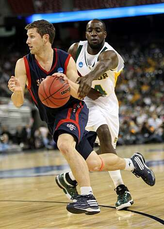Saint Mary's guard Mickey McConnell runs around Baylor forward Quincy Acy during the first half of the 2010 NCAA Men's Basketball South Regional, semifinal college basketball game at Reliant Stadium on Friday in Houston. Photo: Nick De La Torre, Chronicle