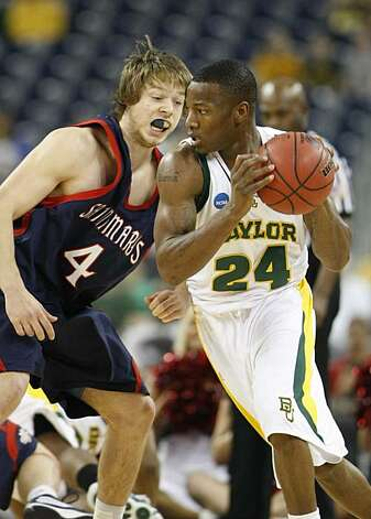 Baylor guard LaceDarius Dunn runs around Saint Mary's guard Matthew Dellavedova during the first half of the 2010 NCAA Men's Basketball South Regional, semifinal college basketball game at Reliant Stadium on Friday in Houston. Photo: Nick De La Torre, Chronicle