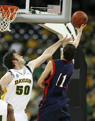 Baylor center Josh Lomers reaches over to defend a shot by Saint Mary's guard Clint Steindl during first half of the 2010 NCAA South Regional semifinal college basketball game at Reliant Stadium on Friday in Houston. Photo: James Nielsen, Chronicle