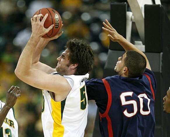 Baylor center Josh Lomers grabs a rebound away from Saint Mary's center Omar Samhan during first half of the 2010 NCAA South Regional semifinal college basketball game at Reliant Stadium on Friday in Houston. Photo: James Nielsen, Chronicle