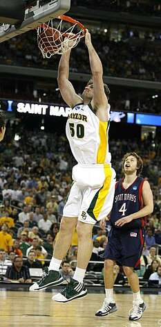 Baylor center Josh Lomers dunks against Saint Mary's during first half of the 2010 NCAA South Regional semifinal college basketball game at Reliant Stadium on Friday in Houston. Photo: James Nielsen, Chronicle