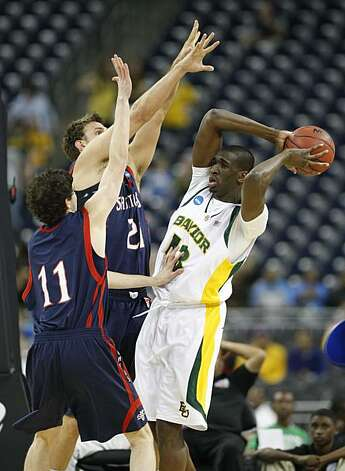 Baylor forward Ekpe Udoh looks to pass the ball against Saint Mary's forward Ben Allen and Clint Steindl during the first half of the 2010 NCAA Men's Basketball South Regional, semifinal college basketball game at Reliant Stadium on Friday in Houston. Photo: Nick De La Torre, Chronicle