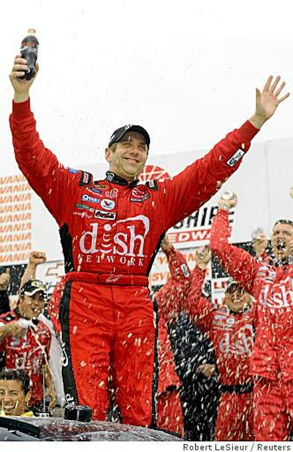 Greg Biffle waves to the fans as he gets out of his car in victory lane after winning the NASCAR Sprint Cup Sylvania 300 at New Hampshire Motor Speedway in Loudon, New Hampshire September 14, 2008.  REUTERS/Robert LeSieur (UNITED STATES) Photo: Robert LeSieur, Reuters