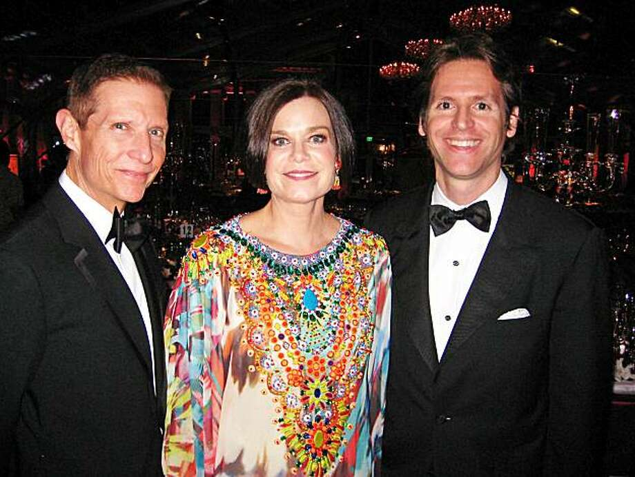 FAM Director John Buchanan with his wife Lucy Buchanan and FAM Trustee Trevor Traina at the Mid-Winter Gala. March 2010. Photo: Catherine Bigelow, Special To The Chronicle