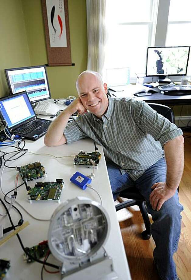 """Joshua Wright, a senior security analyst for InGuardians, poses for a portrait with his hacking tools in his office in East Providence, R.I., Friday, March 26, 2010. InGuardians, which was hired by three utility companies, found flaws in new """"smart"""" meters being installed at homes and businesses across the U.S. Photo: Gretchen Ertl, AP"""