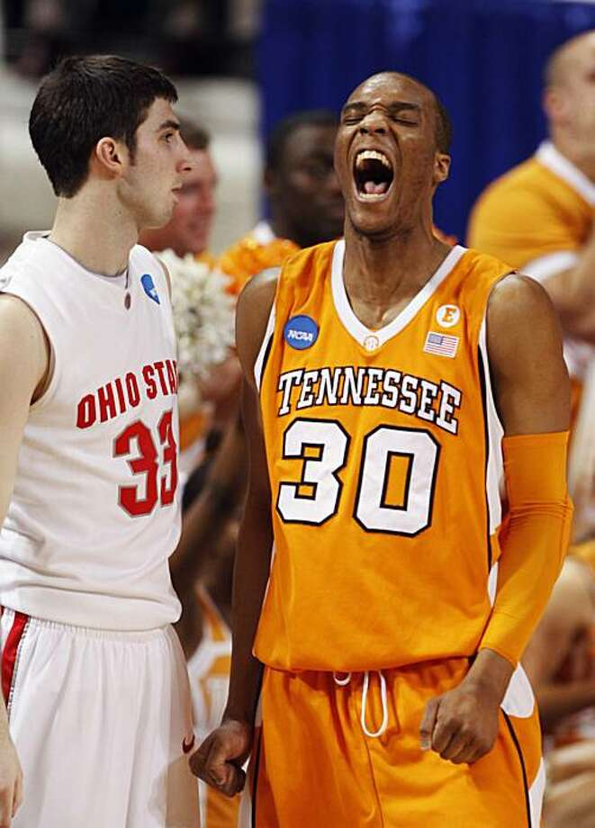Tennessee's J.P. Prince (30) celebrates in front of Ohio State's Jon Diebler (33) after Tennessee's 76-73 win in an NCAA Midwest Regional college basketball game Friday, March 26, 2010, in St. Louis. Photo: Nam Y. Huh, AP