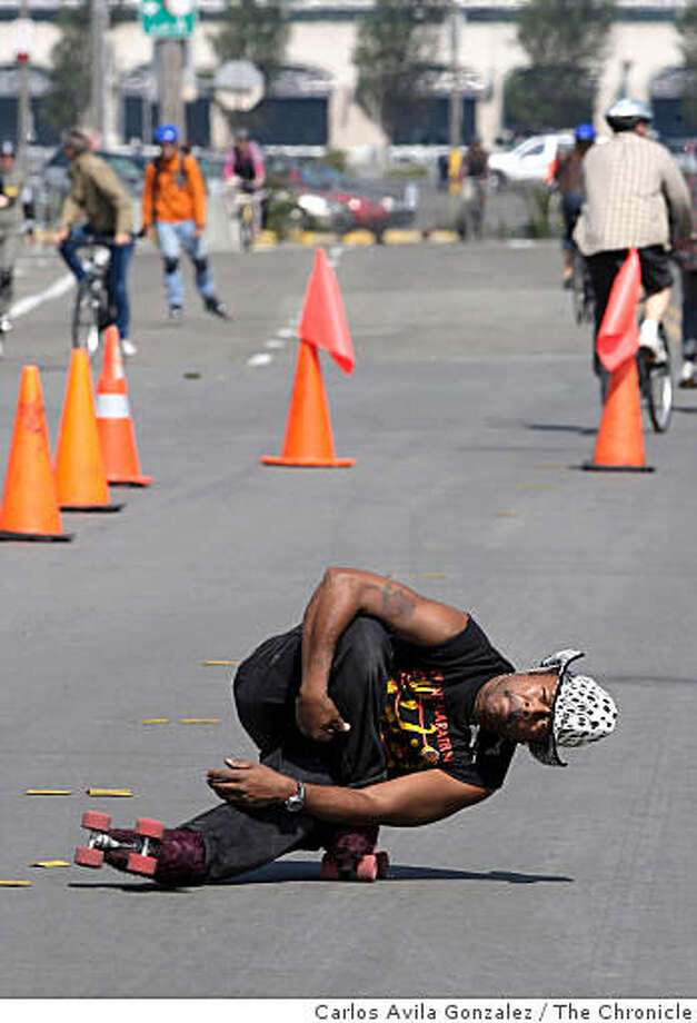 David Miles, Jr., skates on Terry A. Francois Street on Sunday, September 14, 2008, in San Francisco, Ca., during the city's Sunday Streets event.  Sunday is the second and last time this year the city experiments with closing down parts of San Francisco to encourage people to get out and about. The city has partnered with more than 100 sponsors and dozens of free activities will be offered along the route. Photo: Carlos Avila Gonzalez, The Chronicle