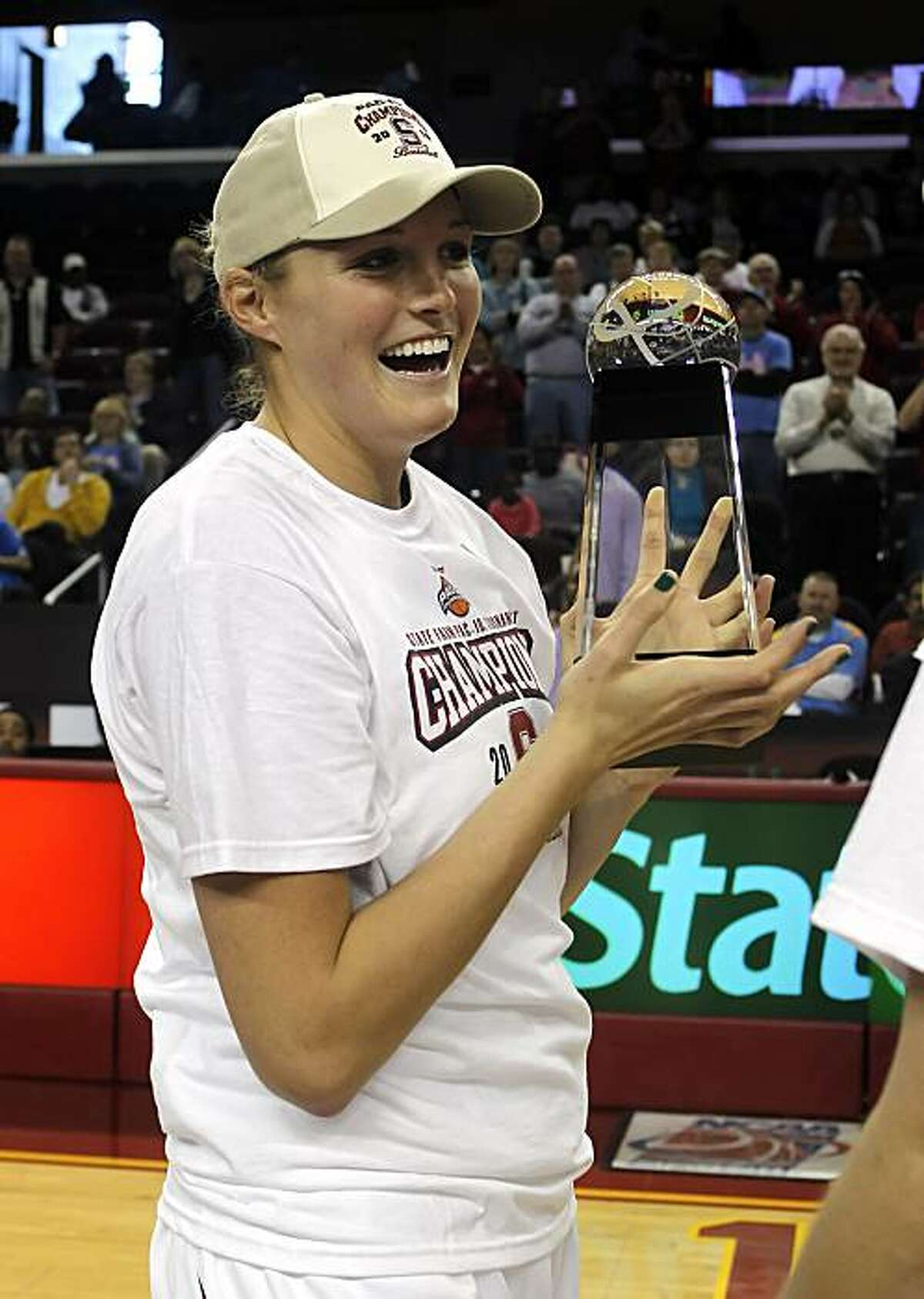 Stanford center Jayne Appel holds up the trophy after Stanford beat UCLA 70-46 in an NCAA college basketball game in the finals of the Pac-10 women's basketball tournament Sunday, March 14, 2010, in Los Angeles.