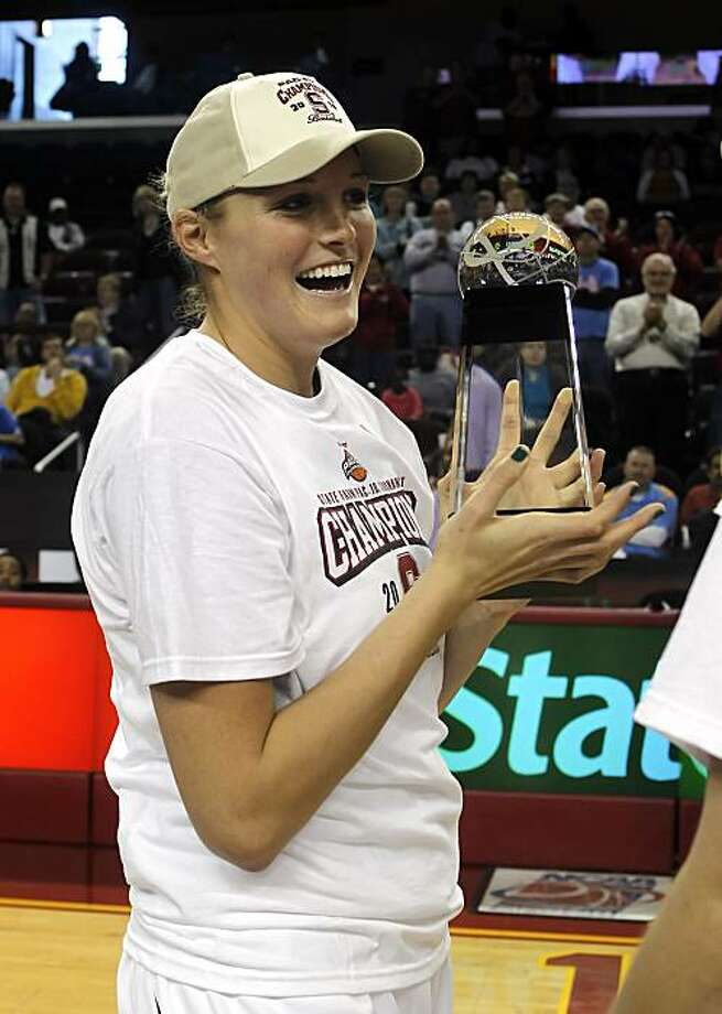 Stanford center Jayne Appel holds up the trophy after Stanford beat UCLA 70-46 in an NCAA college basketball game in the finals of the Pac-10 women's basketball tournament Sunday, March 14, 2010, in Los Angeles. Photo: Alex Gallardo, AP