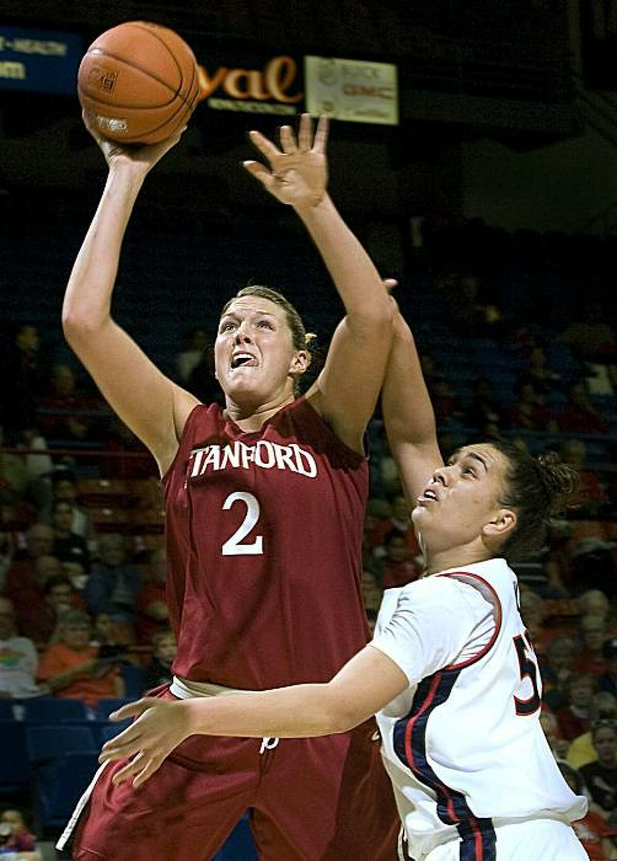 Stanford's Jayne Appel (2) shoots over Arizona's Soana Lucet in the first half of an NCAA college basketball game at McKale Center in Tucson, Ariz., Saturday, Feb. 27, 2010.