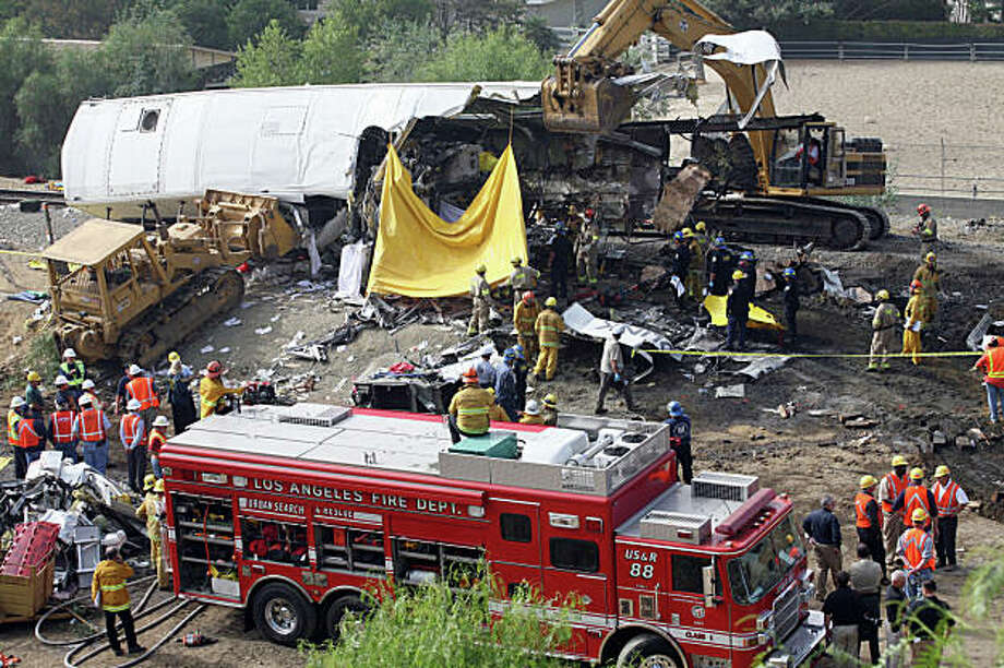 CHATSWORTH, CA - SEPTEMBER 13:  Rescue crews continue to search for survivors at the site of a train crash September 13, 2008 in Chatsworth, California. At least 24 people including a police officer are confirmed dead so far and about 135 of the 225 passengers were injured. Firefighters are still searching for survivors, and finding and recovering the dead. It is reportedly the worst train disaster in Metrolink history.  (Photo by Ringo Chiu/Getty Images) Photo: Ringo HW Chiu, Getty Images / ONLINE_YES