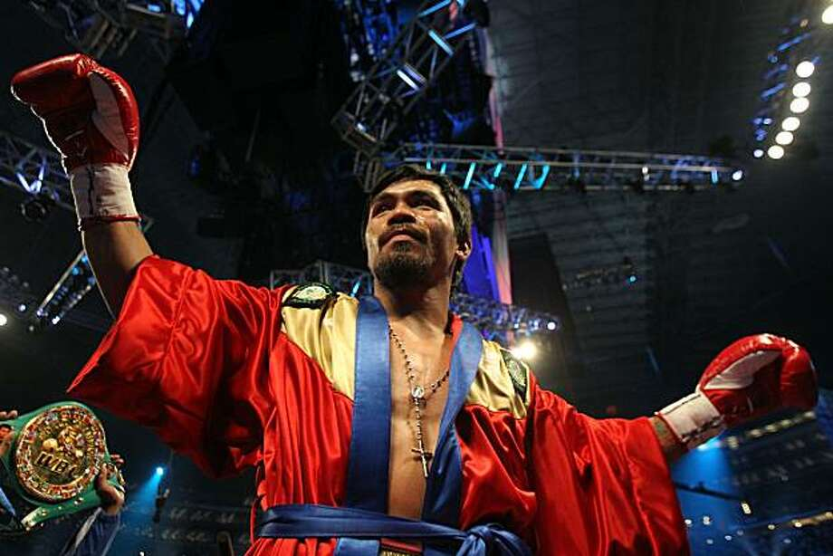 ARLINGTON, TX - MARCH 13:  Manny Pacquiao of the Philippines in the ring before taking on Joshua Clottey of Ghana during the WBO welterweight title fight at Cowboys Stadium on March 13, 2010 in Arlington, Texas. Photo: Jed Jacobsohn, Getty Images