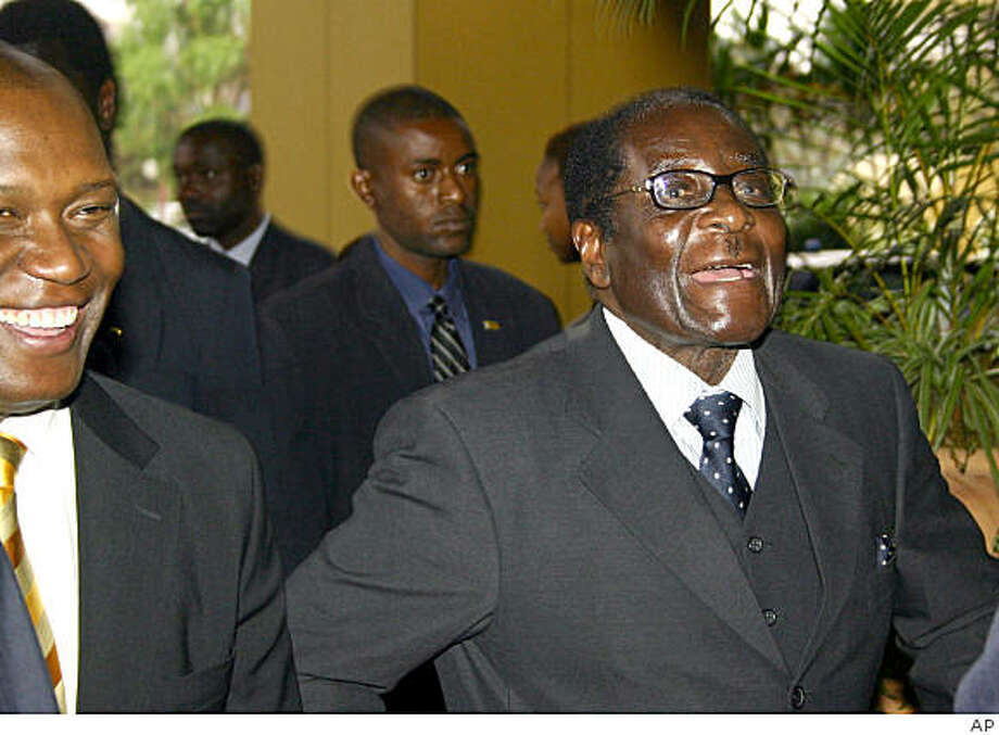 Zimbabwean President Robert Mugabe arrives for talks in Harare, Thursday, Sept. 11, 2008.  South African President  Thabo Mbeki announced that a deal had been struck between the country's leader Mugabe and opposition leader Morgan Tsvangirai. The details will be made available Sunday. (AP Photo) Photo: Ap, AP
