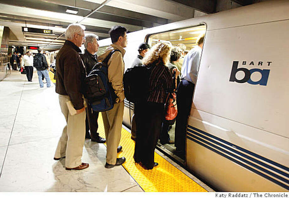 Commuters at Embarcadero Station crowd into a BART car in San Francisco, Calif. BART trains are being reconfigured to pack in more commuters by removing some seats and adding hanging hold straps.Katy Raddatz / The San Francisco Chronicle Photo: Katy Raddatz, The Chronicle