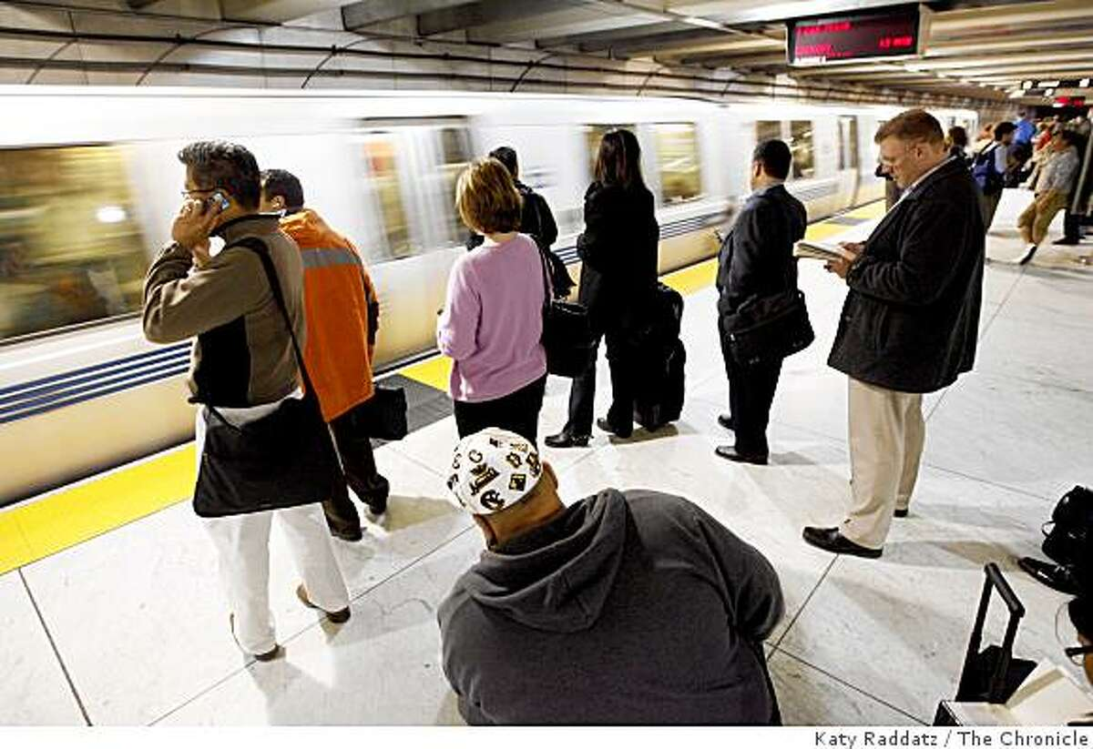 Commuters wait for their BART train at the Powell Street station during the evening commute on May 8, 2008 in San Francisco, Calif.