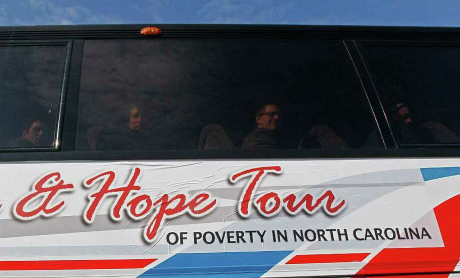 Participants in The Truth & Hope Tour of Poverty in North Carolina look from behind bus windows in Scotland Neck, N.C. Community activism should be encouraged, not discouraged. Photo: Gerry Broome, Associated Press