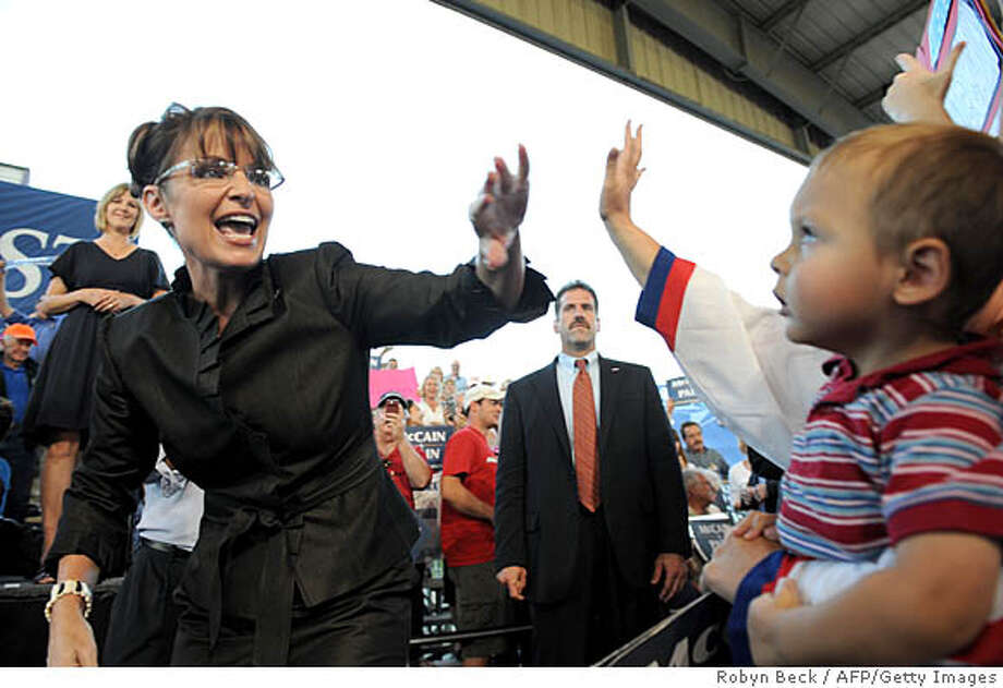 Republican vice presidential candidate Alaska Governor Sarah Palin waves as she arrives at a campaign rally at the Pony Express Pavillion in Mills Park in Carson City, Nevada on September 13, 2008.  AFP PHOTO Robyn BECK (Photo credit should read ROBYN BECK/AFP/Getty Images) Photo: Robyn BECK, AFP/Getty Images